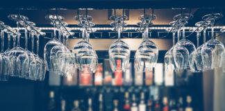 wine glasses at bar